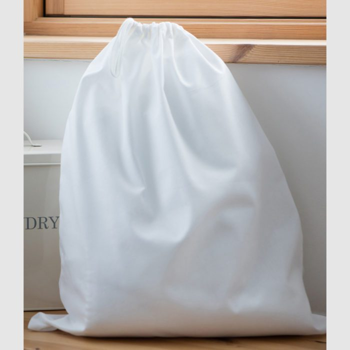 Custom laundry drawstring bag, with draw cords available and a soft fabric