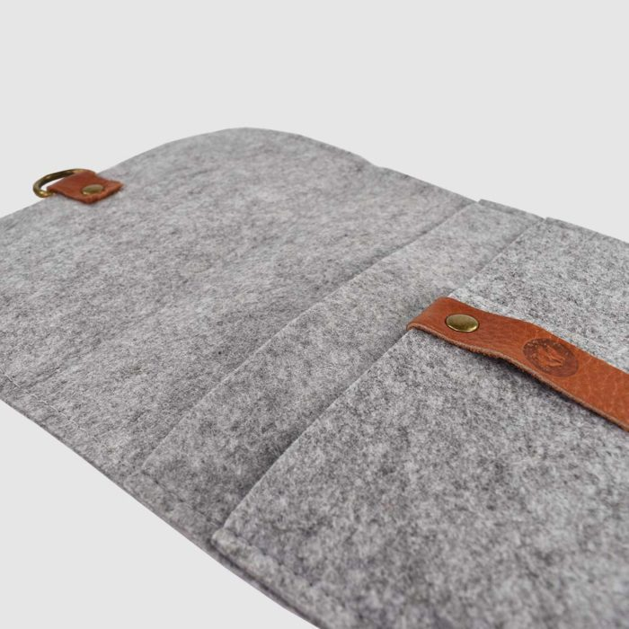 open grey felt folder with brown leather strap