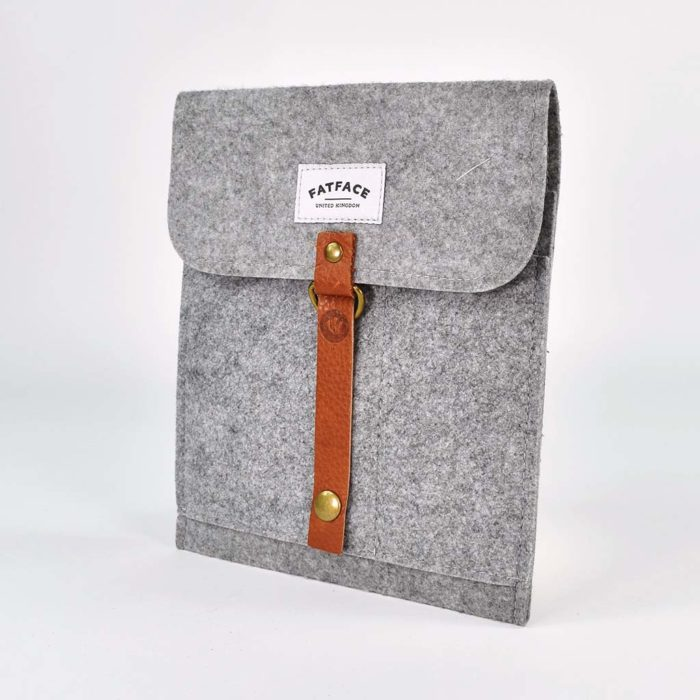 grey felt ipad case with brown leather strap detail