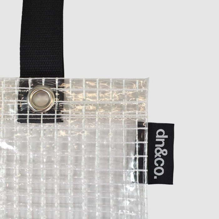 transparent bag with print and woven black logo label