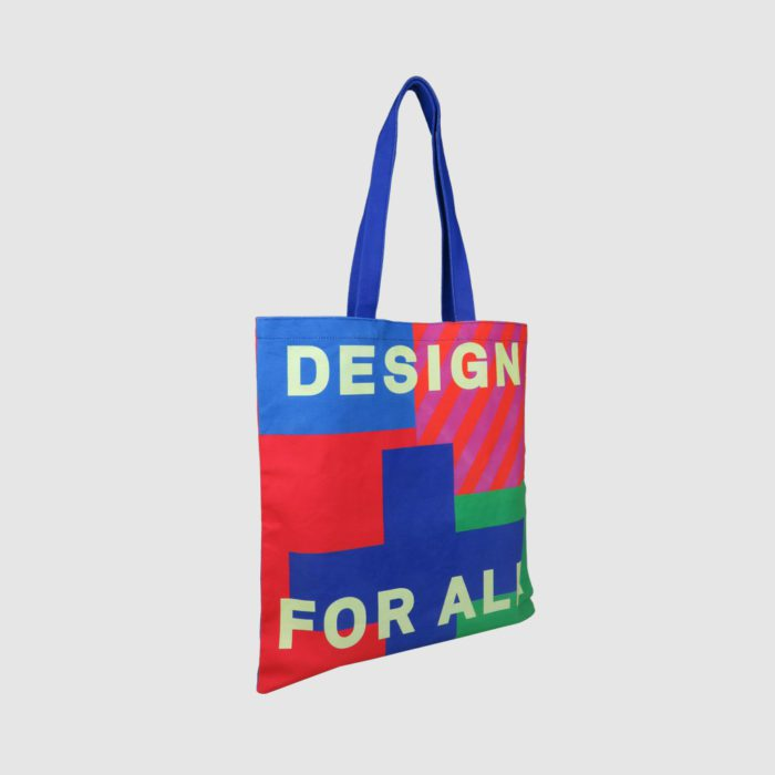 all over print on tote bag bright colours on panels of bag and handles
