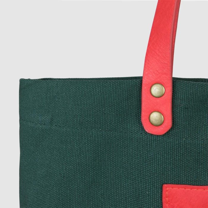 custom premium tote bag with metal rivets on pink leather