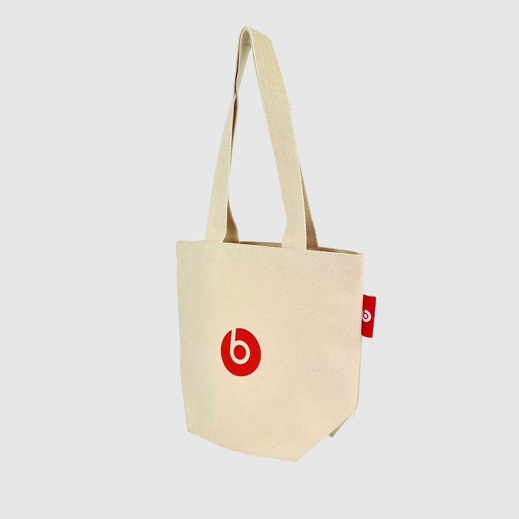 small tote bag in natural fabric with red screen print and label