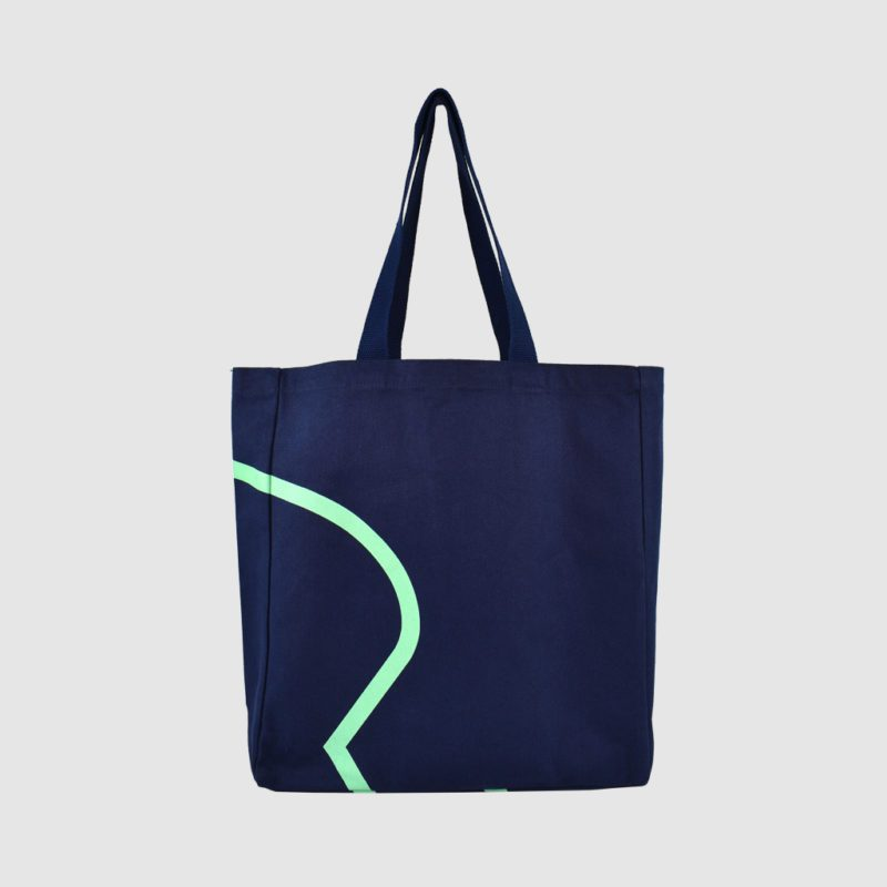 edge to edge print in mint green on large tote bag in navy