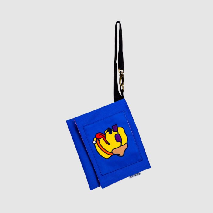 custom cross body bag in royal blue polyester with applique dog on front flap with adjustable black strap