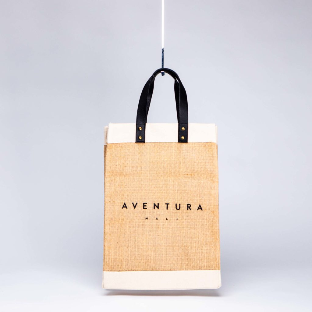 sustainable fabric jute and canvas bag with black leather handles