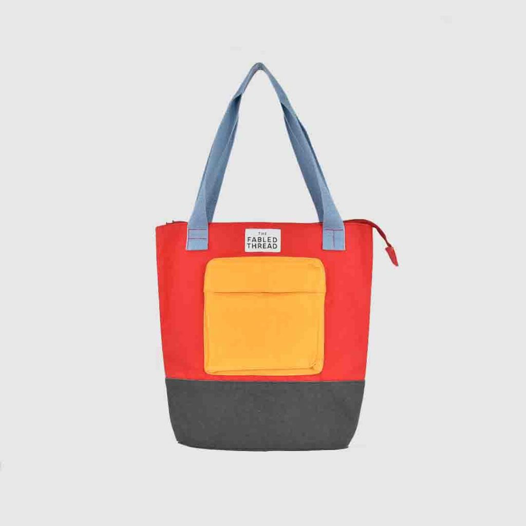 brightly coloured bag with handle