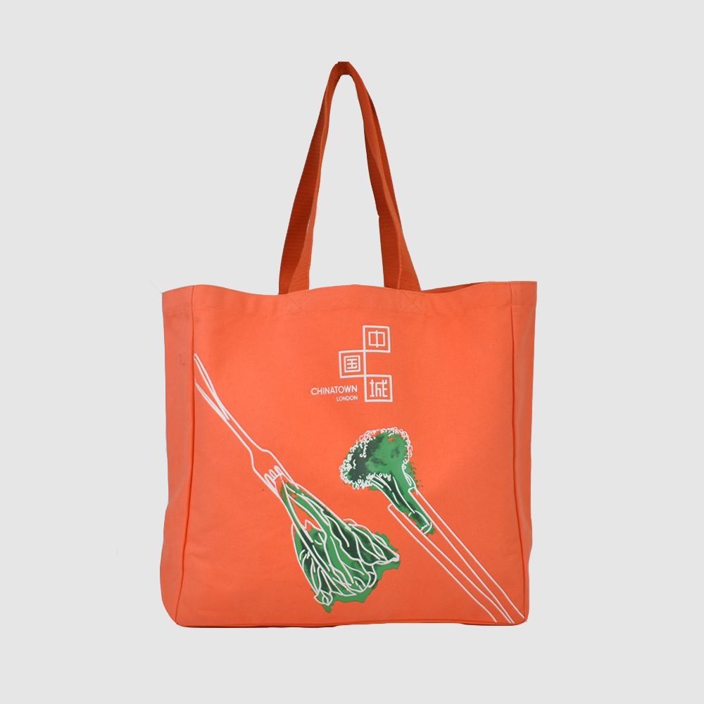 green packaging an eco friendly orange canvas bag with green broccoli